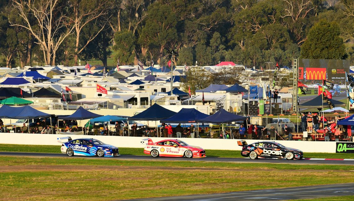 Golding, Coulthard and Jones stream past a jam packed Winton Raceway campsite.